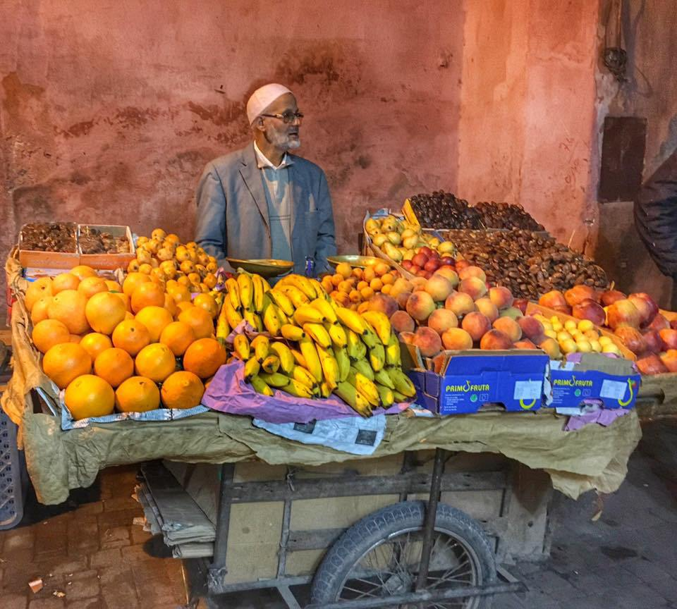 A fruit vendor the medina of Marrakech - The busy, bustling, crowded and wonderful city of Marrakech, Morocco.