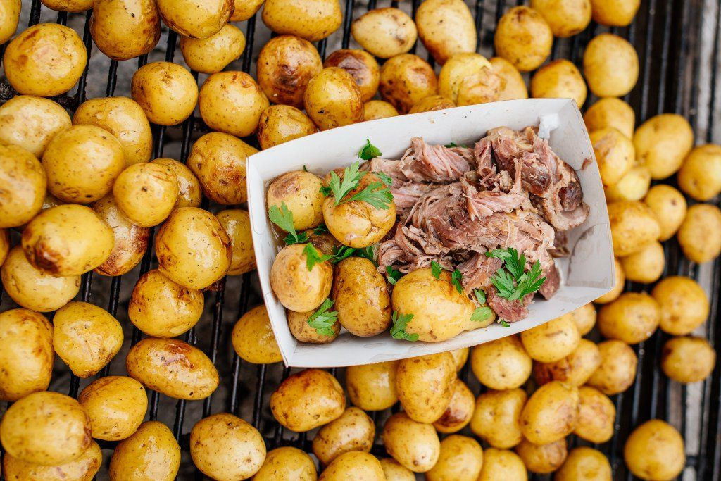 whole roasted pigs with herbed potatoes - Open Kitchen (Odprta Kuhna) Ljubljana, Slovenia